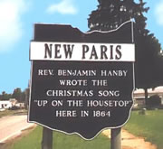New Paris Ohio welcome sign claiming native son who wrote the Christmas Song 'Up on the housetop'